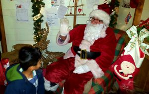 Ludoo cautiously meets Santa..